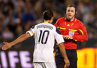 Referee Paul Ward has a discussion with LA Galaxy midfielder Landon Donovan (10). The LA Galaxy defeated the Philadelphia Union 1-0 at Home Depot Center stadium in Carson, California on  April  2, 2011....