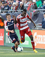 FC Dallas substitute midfielder Je-Vaughn Watson (27) dribbles down the wing as New England Revolution substitute defender Kelyn Rowe (11) defends..  In a Major League Soccer (MLS) match, FC Dallas (red) defeated the New England Revolution (blue), 1-0, at Gillette Stadium on March 30, 2013.