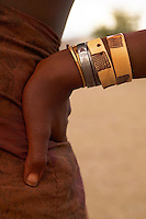 Namibia, 2004 - Hand made bracelets adorn the arm of a Himba woman, Kaokoland, northwestern Namibia.