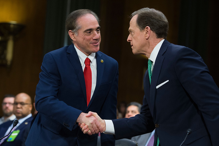 UNITED STATES - FEBRUARY 01: David Shulkin, left, nominee for Veterans Affairs secretary, greets Sen. Pat Toomey, R-Pa., during his Senate Veterans' Affairs Committee confirmation hearing in Dirksen Building, February 1, 2017. Toomey introduced him to the committee. (Photo By Tom Williams/CQ Roll Call)