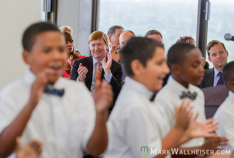 Adam Putnam, Florida Commissioner of Agriculture, background left, claps along with the Tallavana Christian School as they sing during a prayer rally on the National Day of Prayer on the 22nd floor of the Florida Capitol in Tallahassee, Florida.