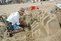 Professional Sand Sculptor from Archisand Ko Tanaka makes a design for the Sea Castle at Santa Monica beach on Saturday, May 14, 2011.