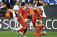 Washington, D.C.- May 29, 2014. Honduras midfielder Roger Ezpinoza gets fouled by Turkey defender Omer Toprak.  Turkey defeated Honduras 2-0 during an international friendly game at RFK Stadium.