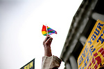 "Mark Chambers holds up a rainbow flag as he sings ""God Bless America"" at City Hall where he celebrates  same-sex marriages with the gay and lesbian community, in San Francisco, CA, on Monday, June 16, 2008. Same sex marriage supports meet protestors at San Francisco's City Hall as the city reopens marriage licenses to same sex couples."