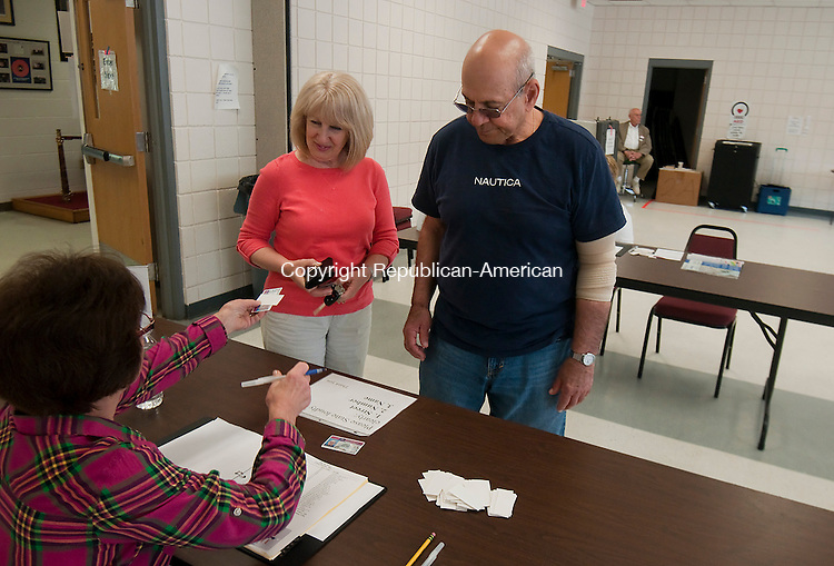 PROSPECT, CT--050515JS03- Prospect residents Marie and Michael Tammara, check in with election official Janet Bruno on Tuesday at the Prospect Fire House, as they cast their vote for the operating budget for Region 16 school district. <br />  Jim Shannon Republican-American WOODBURY, CT--050515JS04-  Woodbury residents check in with election officials at the Woodbury Senior Center on Tuesday as voters from Woodbury and Bethlehem went to the polls on Tuesday for a $32.7 million budget. Woodbury.<br /> Jim Shannon Republican-American