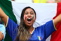 An Italy fan cheers her side on