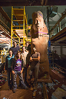 The team of artists from top left pose with Colossus: Joel Erland, Alex Miller, Kate Kaman, James Sullivan, Miguel Antonio Horn, and Cory Kram.