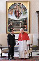 Pope Benedict XVI poses with Mongolian President Tsakhiagiin Elbergdorj (L) at the end of a private audience in his private library at the Vatican on October 17, 2011.