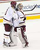 Travis Jeke (BC - 8), Parker Milner (BC - 35) - The Boston College Eagles defeated the visiting University of New Hampshire Wildcats 5-2 on Friday, January 11, 2013, at Kelley Rink in Conte Forum in Chestnut Hill, Massachusetts.