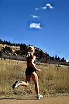 Woman trail running in Palmer Lake