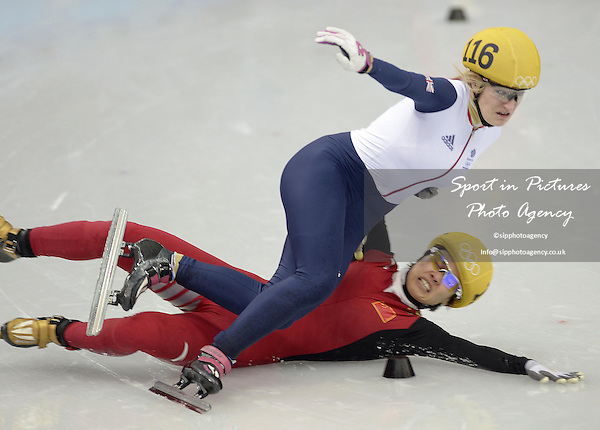 Jianrou LI (CHN) slips and takes out Ellise Christie (GBR) in the semi final. Womens 1000m - Short track skating - Iceberg skating Palace - Olympic Park - PHOTO: Mandatory by-line: Garry Bowden/SIPPA/Pinnacle - Photo Agency UK Tel: +44(0)1363 881025 - Mobile:0797 1270 681 - VAT Reg No: 768 6958 48 - 210214 - 2014 SOCHI WINTER OLYMPICS - Olympic park, Sochii, Russia