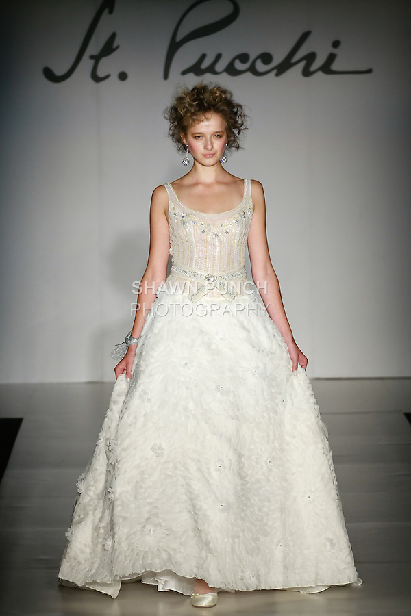 Model walks the runway in a St. Pucchi wedding dress designed by Rani Totman, for the St. Pucchi Spring 2011 bridal runway fashion show, October 17, 2010.