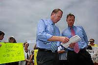 Council Member Kevin Faulconer and Council President Scott Peters compare notes before a joint press conference in Mission Beach Tuesday, July 22rd 2008 to announce that they will bring a proposal to put the ban on the November Ballot before the council at the next meeting.  Residents, business owners and media attended the rally with the overwhelming majority apparently in favor of the alcohol ban.