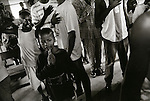 All the boys here have direct combat experience. They are shown at morning assembly at the CAW ( Children Against War) project. They sing the national anthem and prey for forgiveness..Freetown, Sierra Leone, May 1997