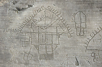 "Petroglyph, rock carving, detail of the so called ""Village"" depicting  houses built on poles . Carved by the ancient Camunni people in the iron age between 1000-1600 BC. Rock no 24,  Foppi di Nadro, Riserva Naturale Incisioni Rupestri di Ceto, Cimbergo e Paspardo, Capo di Ponti, Valcamonica (Val Camonica), Lombardy plain, Italy"
