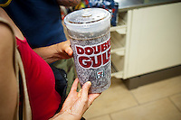 "A 64 ounce ""Double Gulp"" from a 7-Eleven store in New York on Thursday, May 31, 2012. New York Mayor Mike Bloomberg has proposed banning huge sized sugary drinks in an effort to combat the epidemic of obesity.  Bloomberg wants to impose a 16 ounce limit on sweetened beverages sold in graded food establishments and mobile food carts (businesses that the city has control over) with no restrictions on beverages with less than 25 calories per 8 ounces. (© Richard B. Levine)"