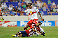 Maykel Galindo (9) of Chivas USA is fouled by Roy Miller (7) of the New York Red Bulls. The New York Red Bulls defeated Chivas USA 1-0 during a Major League Soccer (MLS) match at Red Bull Arena in Harrison, NJ, on June 5, 2010.