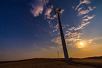 A windmill from the Wintering Hills wind farm south of Drumheller, Alberta, on a Full Moon night, August 31, 2012, a &quot;Blue Moon&quot; night -- the second Full Moon of August. Haze in the sky yellowed the Moon. Cassiopeia is visible at left. Taken with the Canon 7D and 10-22mm lens. Part of a 600 frame time lapse sequence.