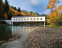 Goodpasture covered bridge with rainbow over the McKenzie River in Lane County, Oregon