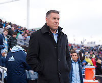 Kansas City head coach Peter Vermes watches his team take the field before the game at PPL Park in Chester, PA.  Kansas City defeated Philadelphia, 3-1.