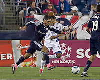 New England Revolution midfielder Benny Feilhaber (22) on the attack as San Jose Earthquakes defender Steven Beitashour (33) defends. In a Major League Soccer (MLS) match, the San Jose Earthquakes defeated the New England Revolution, 2-1, at Gillette Stadium on October 8, 2011.