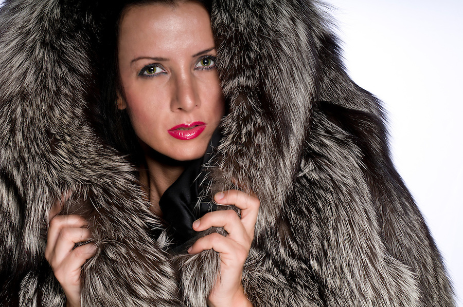 Portrait of a beautiful caucasian woman with a fur.