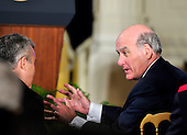 Outgoing White House Chief of Staff William Daley engages in a discussion with an unidentified person prior to United States President Barack Obama making remarks in the East Room of the White House in Washington, D.C. calling on Congress to return powers that would allow him to reform Executive Branch agencies of the U.S. Government on Friday, January 13, 2012..Credit: Ron Sachs / CNP