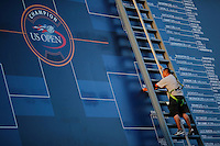 A workers put results of the games during the US Open 2014 tennis tournament at the USTA Billie Jean King National Center in New York.  08.29.2014. VIEWpress