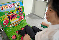 A game designed to be played by elderly people. Players tap the snakes with their feet when the pop out. It can be played by people with limited mobility and energy.