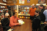 "Retired St. Louis Cardinals manager Tony La Russa signs copies of his book ""One Last Strike"" for Whitman Rowland at Square Books in Oxford, Miss. on Thursday, November 29, 2012."