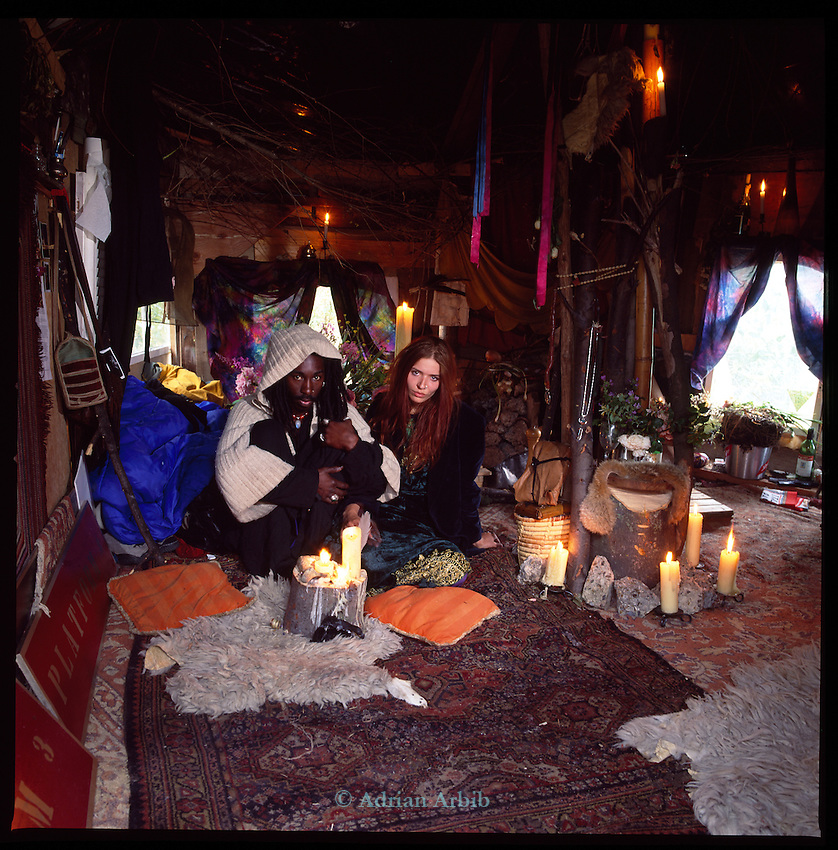 Eve and Kira in their homemade house on the site of the Wandsworth Eco village.