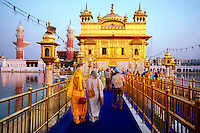 Sikhs approaching the Golden Temple (holiest Sikh shrine), Amritsar, Punjab, India