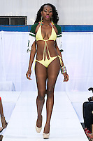Model walks runway in a Marseille Fashion swimsuit by Nabu & David, during the JRG Bikini Under The Bridge 2012 fashion show on July 9, 2012.