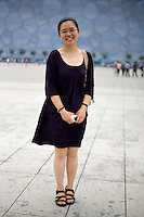 Guowenshu, a student, age 26, poses for a portrait in Beijing. Response to 'What does China mean to you?': 'Home country.'  Response to 'What is your role in China's future?': 'Head of the house.'