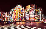 Akihabara streets with shining colorful signs at nighttime in Tokyo, Japan.
