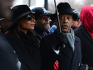 Washington, DC - January 14, 2017: Rev. Al Sharpton, president of the National Action Network, accompanied by Aisha McShaw, leads a march of hundreds of people, January 14, 2017, to recommit to Dr. Martin Luther King's vision. The march comes one week before the inauguration of president-elect Donald Trump.   (Photo by Don Baxter/Media Images International)