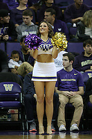 December 22, 2013:  Washington cheerleader Kaylie Gray entertained fans during a timeout against Connecticut.  Connecticut defeated Washington 82-70 at Alaska Airlines Arena Seattle, Washington.