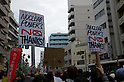 April 10, 2011 - Protesters display placards as they march through the streets of Koenji, Tokyo, Japan..According to the organisers 15,000 attended the protest more conservative estimates put the number at 5000. (Photo by B.Meyer-Kenny/2.0 images)