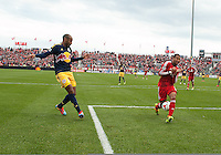 Toronto, Ontario - May 17, 2014: New York Red Bulls forward Thierry Henry #14 attempts to kick a ball past Toronto FC defender Justin Morrow #2 during the second half in a game between the New York Red Bulls and Toronto FC at BMO Field. Toronto FC won 2-0.