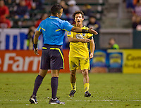 Columbus Crew forward Guillermo Barros Schelotto (7) has a few choice words for referee Hillario Grajeda. CD Chivas USA defeated the Columbus Crew 3-1 at Home Depot Center stadium in Carson, California on Saturday July 31, 2010.