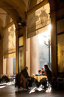 Piazza San Carlo in Turin surrounded by large porticoes with popular bars, cafes, and pasticcerie, Italy