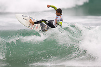 Brazilian Gabriel Medina tears into a inside shorebreak section during round of 48 at the 2010 US Open of Surfing in Huntington Beach, California on August 5, 2010.