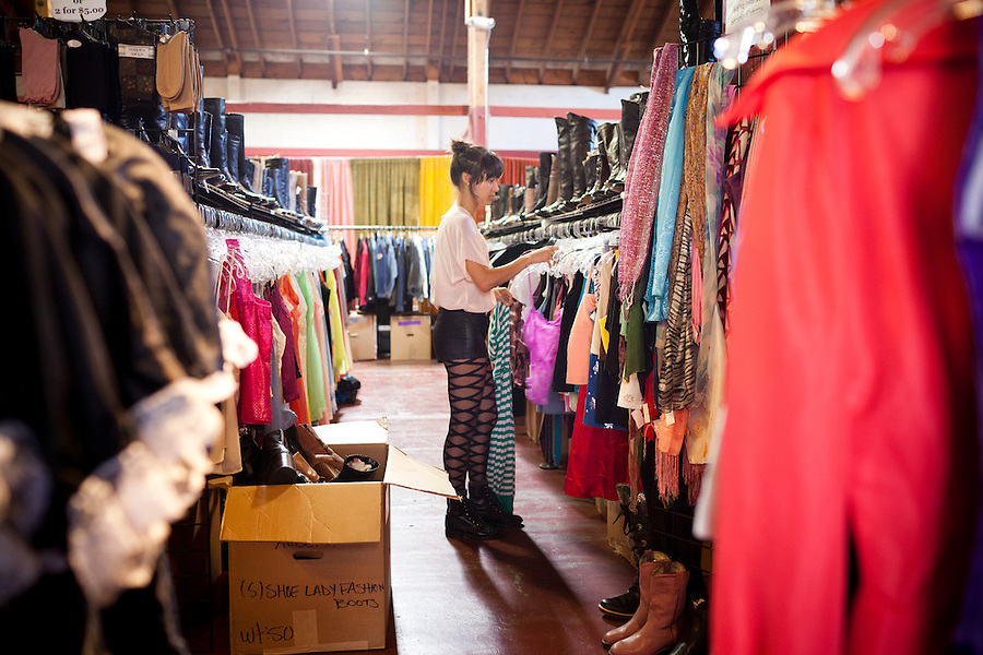 Reeva Milligan straightens clothes while she works at Aubergine Vintage Emporium, in Sebastopol, CA., on Saturday, Oct 9, 2011. In recent years, new restaurants, shops and live music venues have opened in Sebastopol, securing the town as an arts and culture hub.