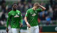 FUSSBALL   1. BUNDESLIGA   SAISON 2012/2013    26. SPIELTAG SV Werder Bremen - Greuther Fuerth                        16.03.2013 Assani Lukimya (li und Nils Petersen (re, beide SV Werder Bremen) sind nach dem Abpfiff enttaeuscht