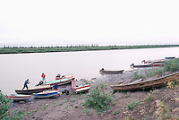Boats anchored on Mackenzie River near Inuvik, NWT, Northwest Territories, Arctic Canada