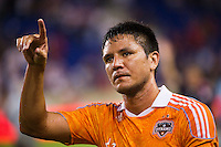 Brian Ching (25) of the Houston Dynamo salutes the fans after the game. The New York Red Bulls defeated the Houston Dynamo 2-0 during a Major League Soccer (MLS) match at Red Bull Arena in Harrison, NJ, on August 10, 2012.