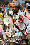 Lonnie Harrington, Seminole Native and African American dancer in traditional regalia.<br /> <br /> Inter-Tribal Dancing a celebration of ethnic Native American pride and heritage  at Thunderbird Pow Wow in Queens NY.<br /> <br /> A pow-wow (also powwow or pow wow or pau wau) is a gathering of North America's Native people. The word derives from the Narragansett word powwaw, meaning &quot;spiritual leader&quot;.