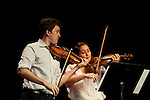 Stephen Miahky, left, and Christina McGann, right, perform a violin duet at Arts West on August 7, 2012 during Ohio University's Mozart on the Green Chamber Music Festival and Academy in Athens, Ohio.