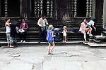 Tourists take a break inside the central temple complex at Angkor Wat, Cambodia. June 7, 2013.