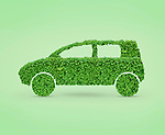 Green car. Automobile shape made from green leaves. Isolated on green background.